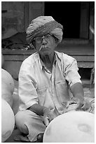 Man with turban holding a jar. Jodhpur, Rajasthan, India ( black and white)