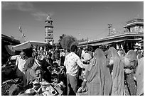 Sadar Market, with women in colorful sari and clock tower. Jodhpur, Rajasthan, India (black and white)