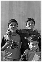 Young boys in front of blue wall. Jodhpur, Rajasthan, India ( black and white)