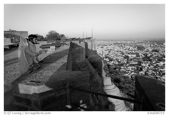 Couple looking at the view from Mehrangarh Fort. Jodhpur, Rajasthan, India (black and white)