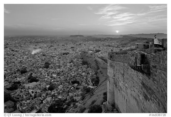 Mehrangarh Fort walls, blue houses, and setting sun. Jodhpur, Rajasthan, India (black and white)