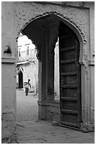 Archway with woman carrying water in courtyard. Jodhpur, Rajasthan, India ( black and white)