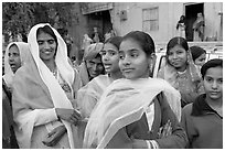 Women standing in the street during a wedding. Jodhpur, Rajasthan, India ( black and white)