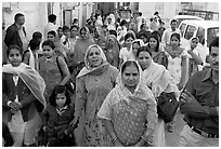 Old town street with wedding procession. Jodhpur, Rajasthan, India ( black and white)