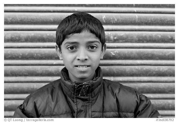 Boy with insulated jacket. Jodhpur, Rajasthan, India (black and white)