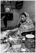 Woman with headscarf stacking chapati bread. Jodhpur, Rajasthan, India ( black and white)