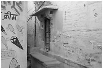 Whitewashed walls with indigo tint and ice-cream depictions. Jodhpur, Rajasthan, India ( black and white)