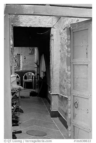 Doorway and inside of a house painted blue. Jodhpur, Rajasthan, India (black and white)