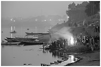 Cremation fire on banks of Ganges River. Varanasi, Uttar Pradesh, India (black and white)