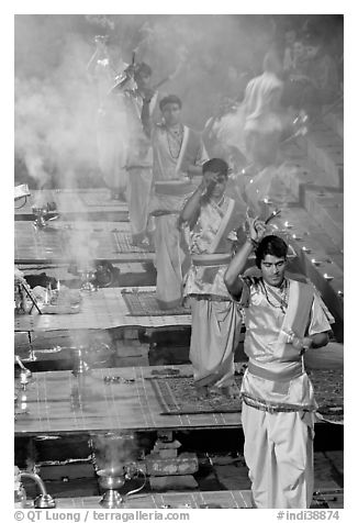 Five young Brahmans performing puja ceremony in the evening. Varanasi, Uttar Pradesh, India (black and white)