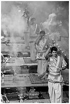 Five young Brahmans performing puja ceremony in the evening. Varanasi, Uttar Pradesh, India ( black and white)