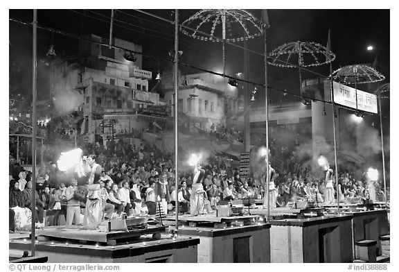 Pujari (priests) performing arti ceremony in front of large attendance. Varanasi, Uttar Pradesh, India (black and white)
