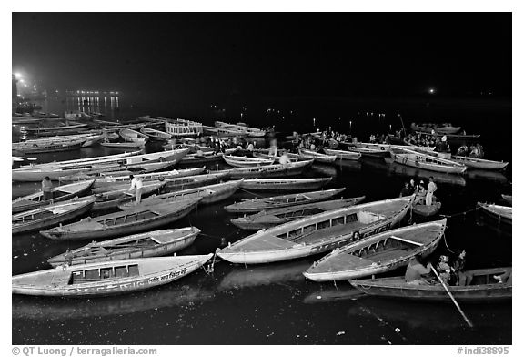 Boats on the Ganges River at night during arti ceremony. Varanasi, Uttar Pradesh, India (black and white)