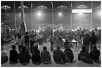 Worshipers attending arti ceremony at Ganga Seva Nidhi. Varanasi, Uttar Pradesh, India (black and white)