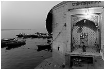 Shrine on the banks of the Ganges River at dawn. Varanasi, Uttar Pradesh, India (black and white)