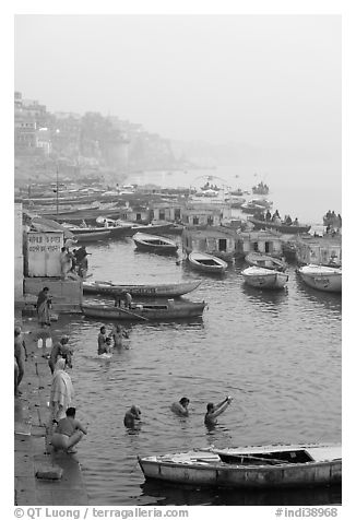 Pilgrims taking a holy dip in the Ganga River at dawn. Varanasi, Uttar Pradesh, India (black and white)