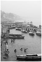 Pilgrims taking a holy dip in the Ganga River at dawn. Varanasi, Uttar Pradesh, India ( black and white)