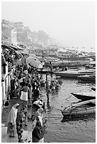 People and boats on the banks of the Ganges River, Dasaswamedh Ghat. Varanasi, Uttar Pradesh, India ( black and white)