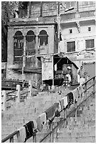 Laundry on hand-rail of ghat steps. Varanasi, Uttar Pradesh, India (black and white)