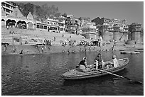 Rowboat in front of Scindhia Ghat. Varanasi, Uttar Pradesh, India (black and white)