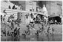 Hindu people on the steps of Sankatha Ghat. Varanasi, Uttar Pradesh, India (black and white)