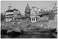 Huge piles of firewood stacked at Manikarnika Ghat. Varanasi, Uttar Pradesh, India (black and white)