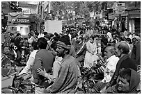 Riders waiting in congested street. Varanasi, Uttar Pradesh, India ( black and white)