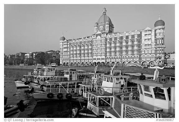 Tour boats and Taj Mahal Palace Hotel. Mumbai, Maharashtra, India (black and white)