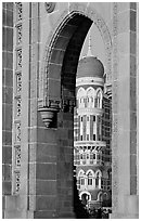Taj Mahal Palace Hotel seen through arch of Gateway of India. Mumbai, Maharashtra, India (black and white)