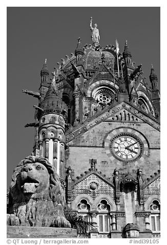 Lion and Gothic tower topped by 4m-high statue of Progress, Victoria Terminus. Mumbai, Maharashtra, India (black and white)