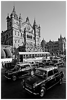 Black and Yellow cabs in front of Victoria Terminus. Mumbai, Maharashtra, India (black and white)