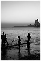 Beachgoers and skyline, Chowpatty Beach. Mumbai, Maharashtra, India (black and white)
