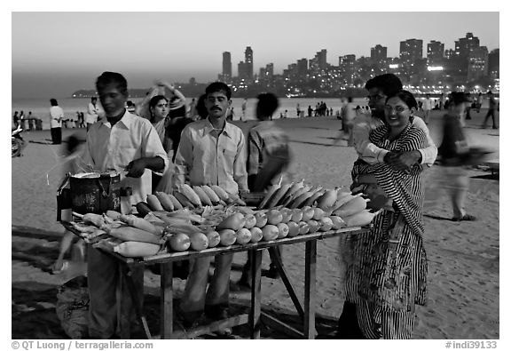 Corn stall at twilight, Chowpatty Beach. Mumbai, Maharashtra, India (black and white)
