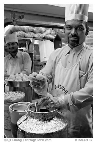 Cooks in food stall, Chowpatty Beach. Mumbai, Maharashtra, India (black and white)