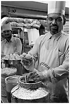 Cooks in food stall, Chowpatty Beach. Mumbai, Maharashtra, India ( black and white)