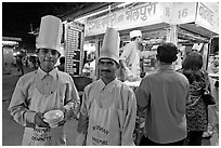 Cooks in front of Panipuri stall, Chowpatty Beach. Mumbai, Maharashtra, India ( black and white)