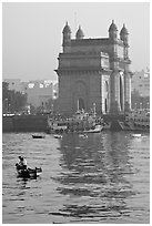 Small boat and Gateway of India, early morning. Mumbai, Maharashtra, India (black and white)