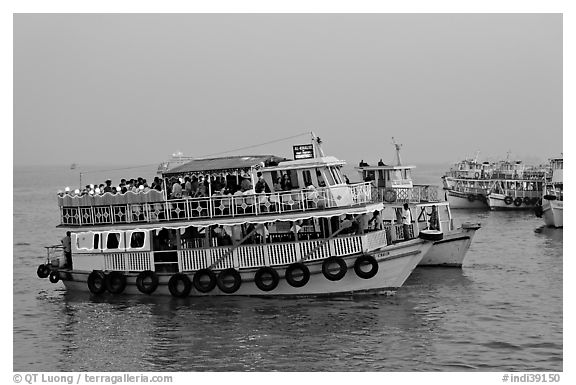 Tour boat at twilight. Mumbai, Maharashtra, India (black and white)