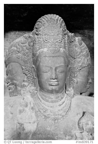 Triple-headed Shiva sculpture, Elephanta caves. Mumbai, Maharashtra, India (black and white)