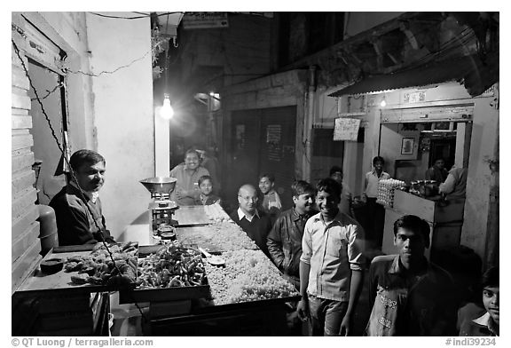 Street with vendor of sweets by night, Taj Ganj. Agra, Uttar Pradesh, India (black and white)