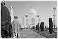 Men with turbans walking toward Taj Mahal, early morning. Agra, Uttar Pradesh, India (black and white)