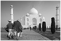 Men walking toward Taj Mahal, early morning. Agra, Uttar Pradesh, India (black and white)