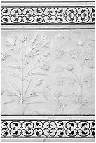 Bas reliefs and pietra dura inlays of flowers, Taj Mahal. Agra, Uttar Pradesh, India (black and white)