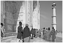 Colorful tourists on the platform, Taj Mahal,. Agra, Uttar Pradesh, India (black and white)