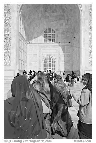 Women in front of main Iwan, Taj Mahal,. Agra, Uttar Pradesh, India