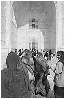 Women in front of main Iwan, Taj Mahal,. Agra, Uttar Pradesh, India (black and white)