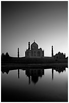 Taj Mahal reflected in  Yamuna River at sunset. Agra, Uttar Pradesh, India (black and white)