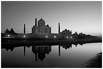Taj Mahal complex reflected in Yamuna River at sunset. Agra, Uttar Pradesh, India (black and white)