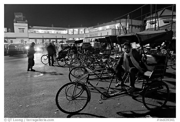 Cycle-rickshaws in front of train station. Agra, Uttar Pradesh, India (black and white)