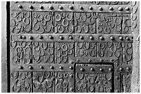 Detail of door with horseshoes, Dargah (Jama Masjid) mosque. Fatehpur Sikri, Uttar Pradesh, India ( black and white)